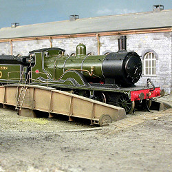 Southern Railway T9 Class 4-4-0 locomotive No. 710 is provisioned and turned at Pen Tor Road ready for a return journey. These engines, known as 'Greyhounds', were built by the London and South Western Railway for express passenger work.